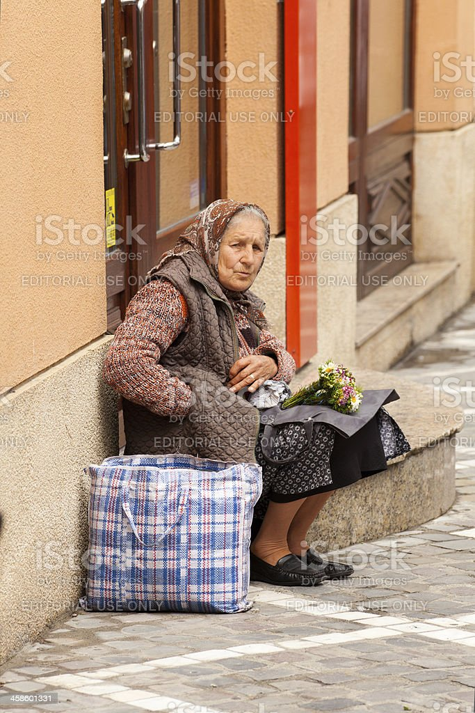 Lady sits on a step Brasov, Romania stock photo