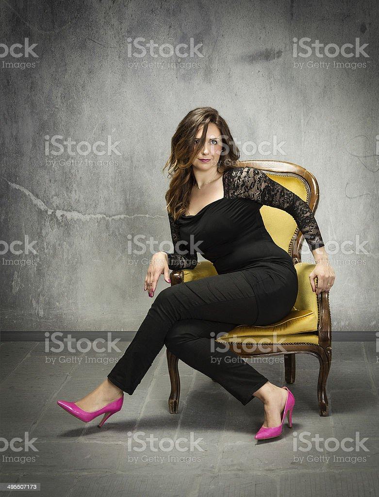 lady sitting on armchair stock photo