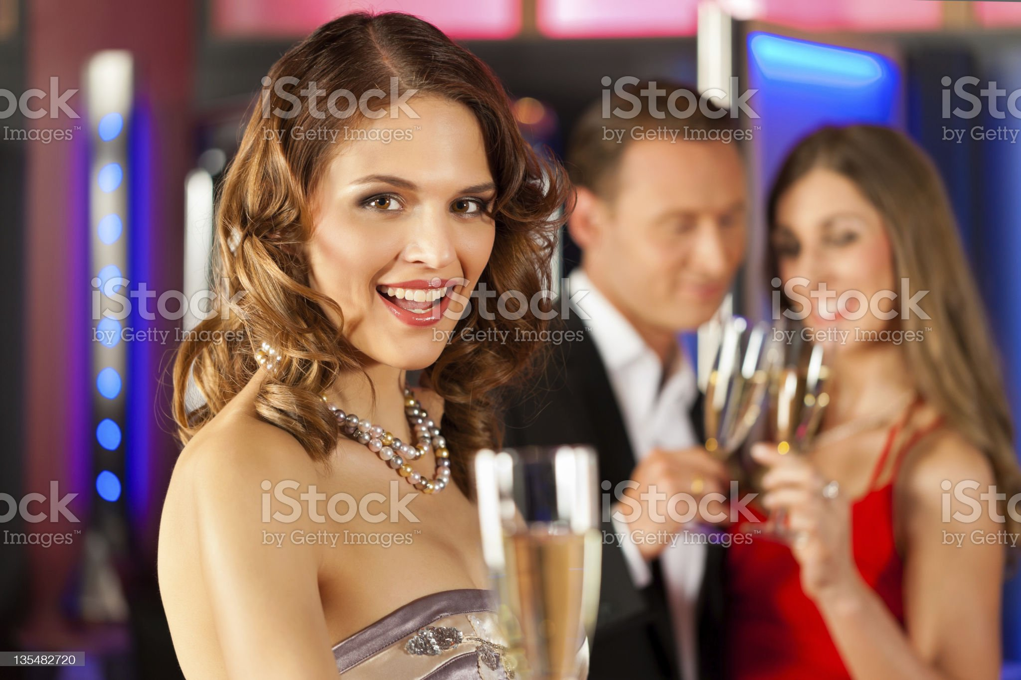 A lady smiling whilst drinking champagne in a bar royalty-free stock photo