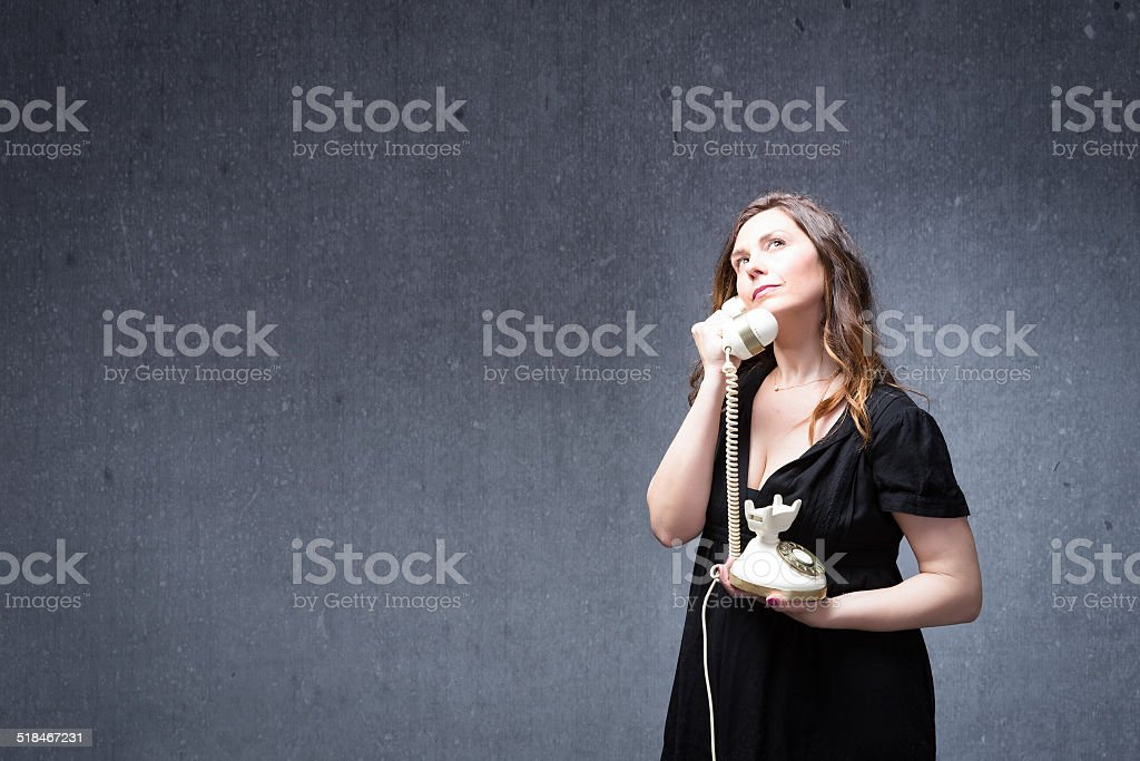 lady speaking on an old house phone stock photo