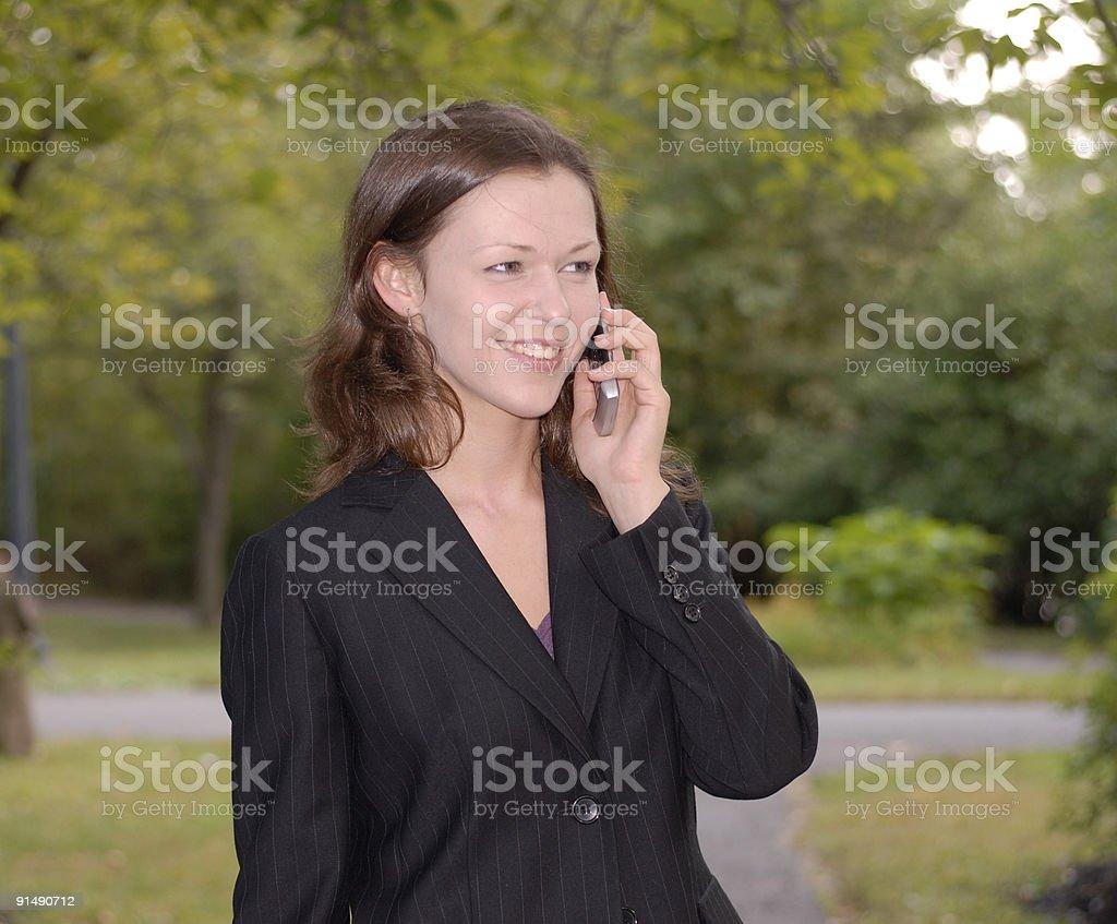 Lady speaking on phone smiling 21 royalty-free stock photo