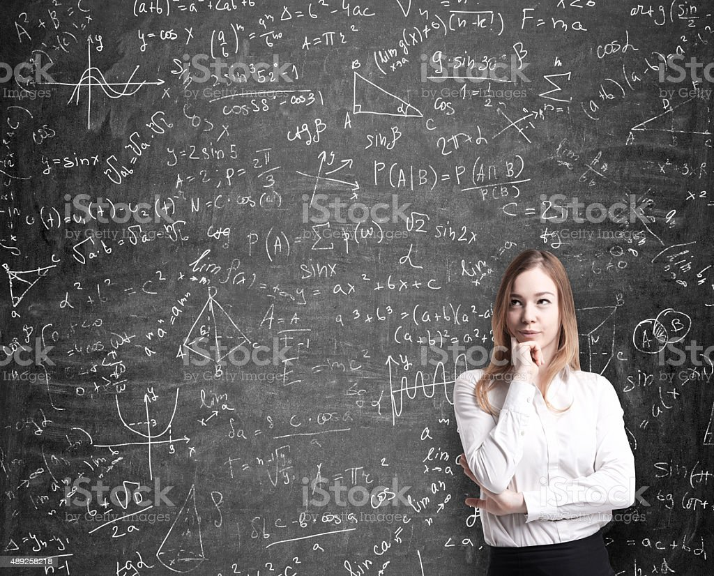 lady thinking about possible solutions of the quantitative problems stock photo