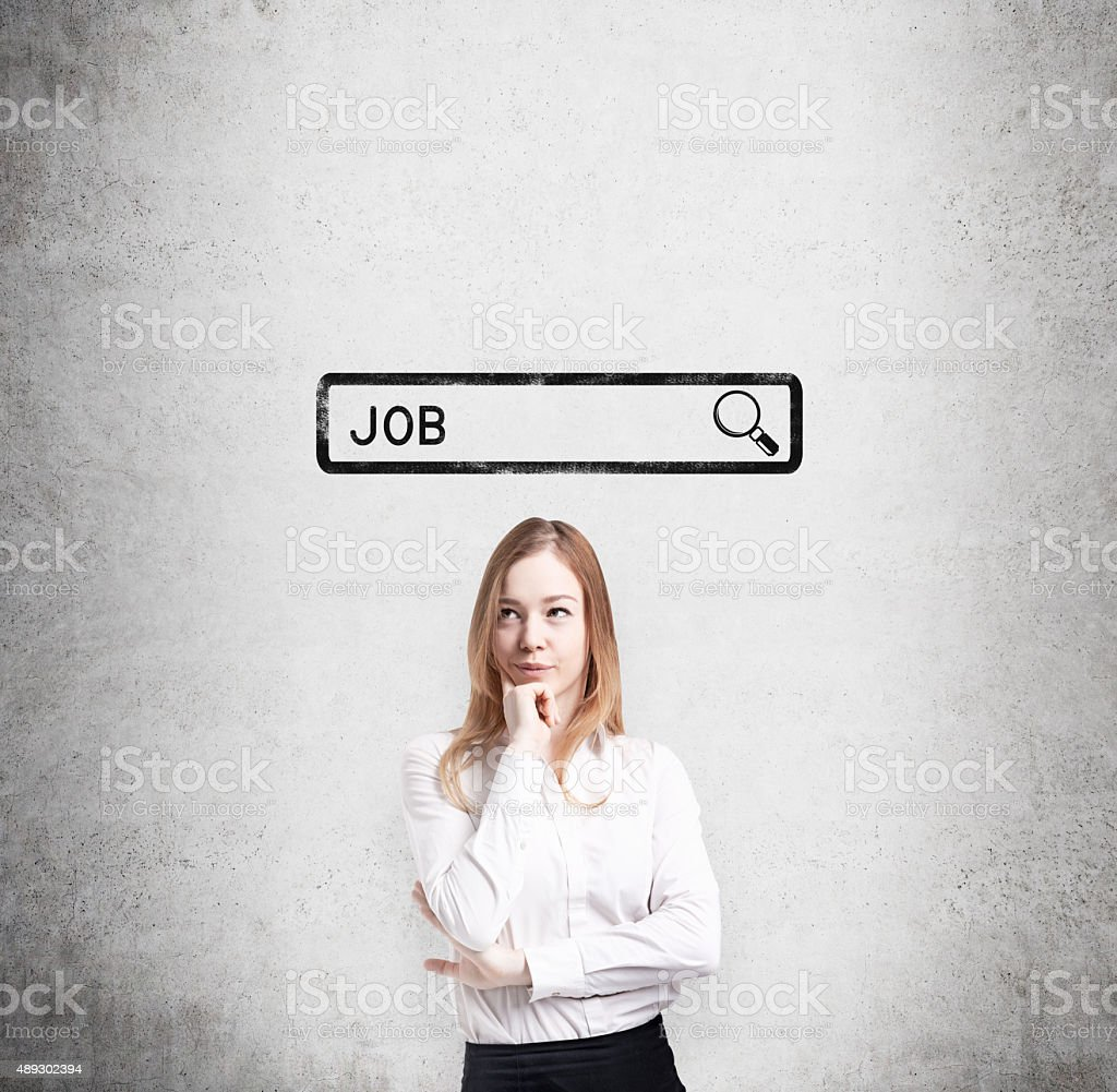 lady thinking about the best way to find a job. stock photo