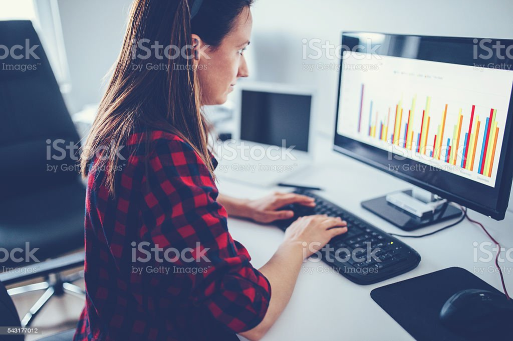 Lady typing in firm stock photo