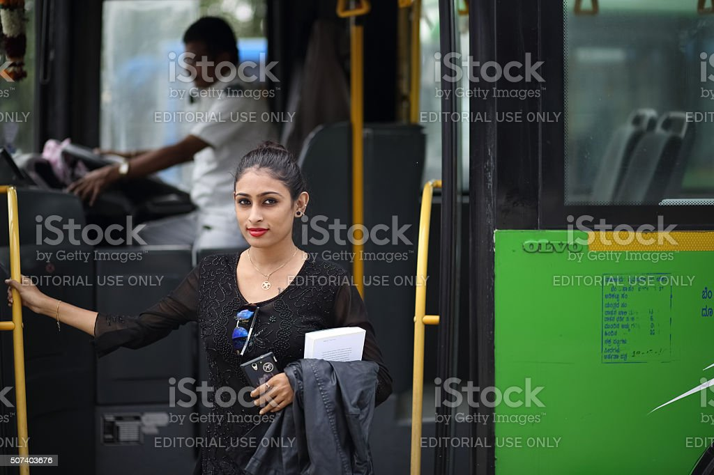 Lady Unboarding the Bus stock photo