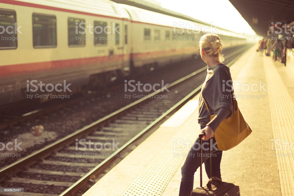 Lady waiting at the railway station. stock photo