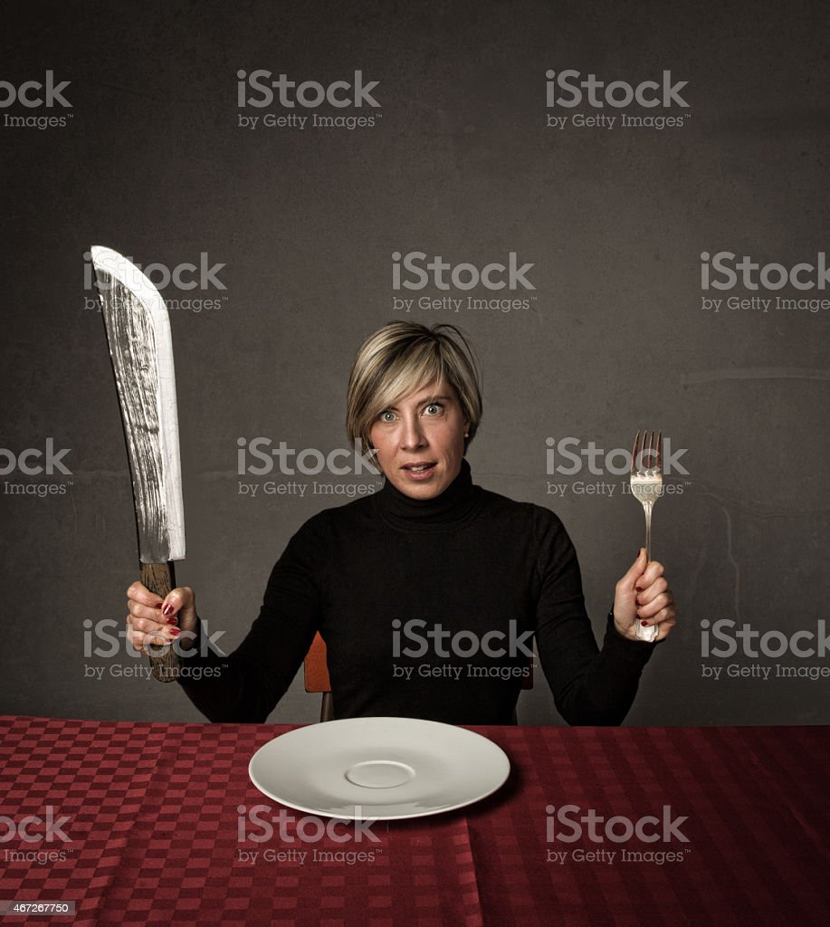 lady waiting for food or for a terrible diet stock photo