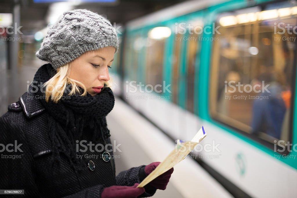 Lady waiting on subway station platform. stock photo