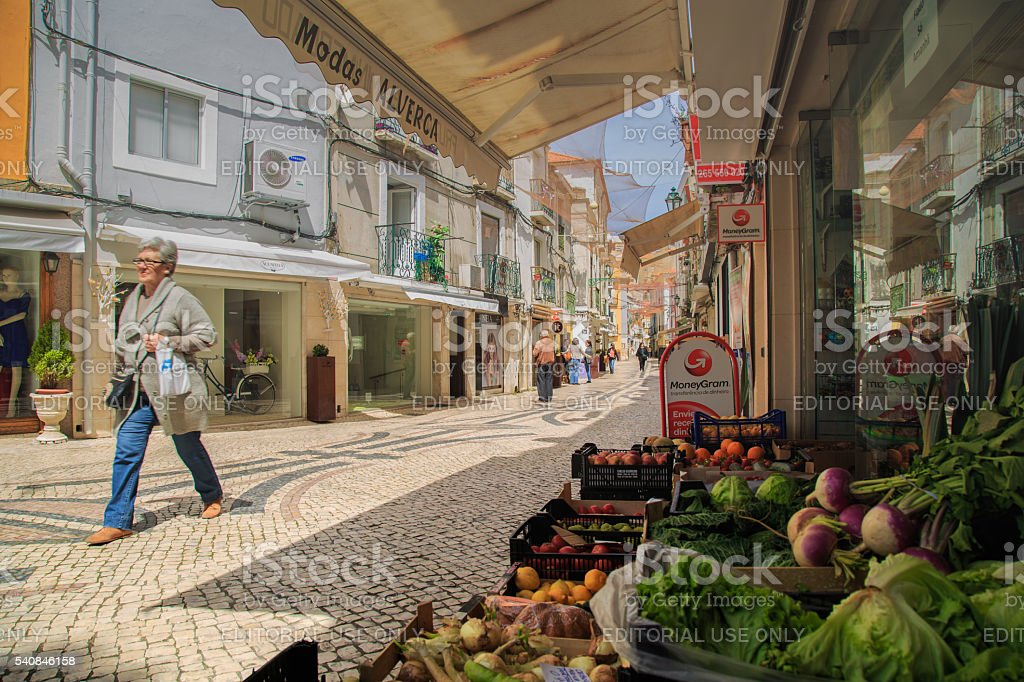 Lady walking a paved alley stock photo