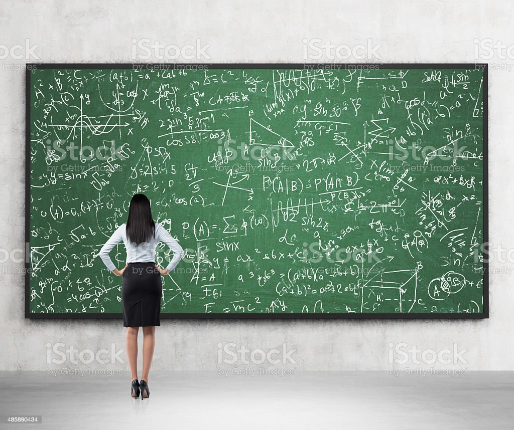 lady who is looking at formulas stock photo