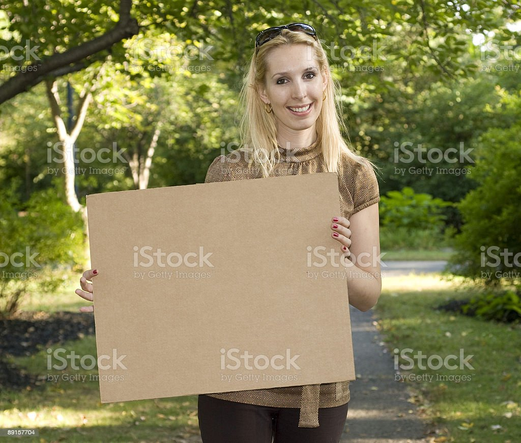 Lady with a sign 3 royalty-free stock photo