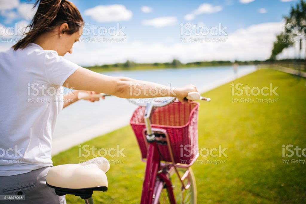 Lady with bicycle stock photo