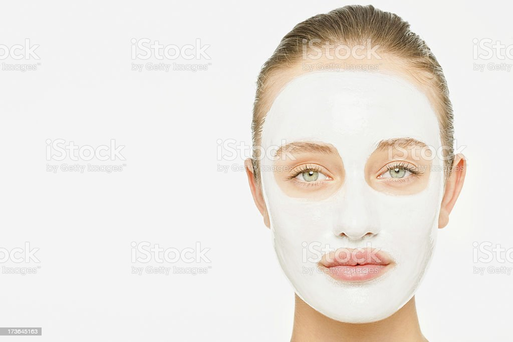 Lady with cosmetic mask over white background stock photo