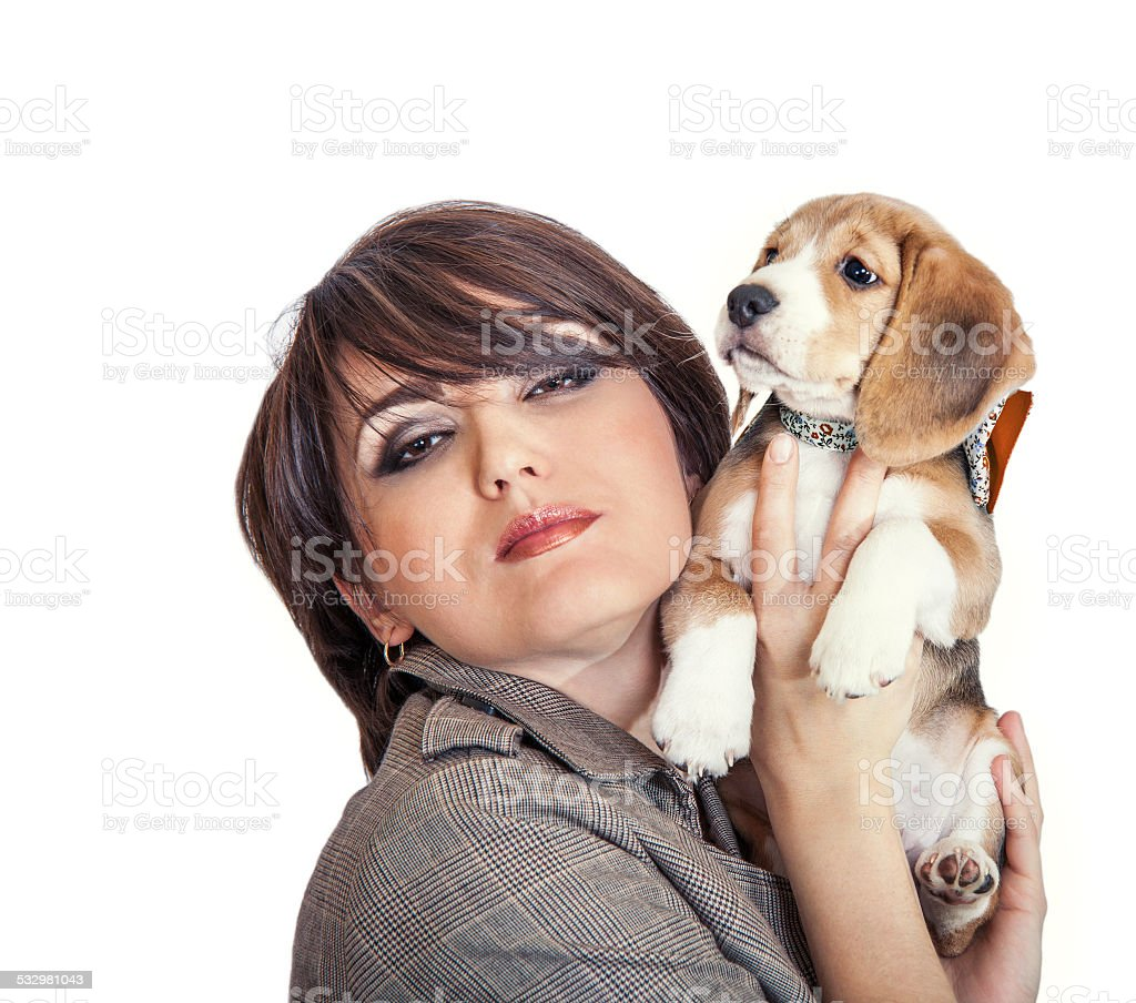 Lady with cute beagle puppy stock photo