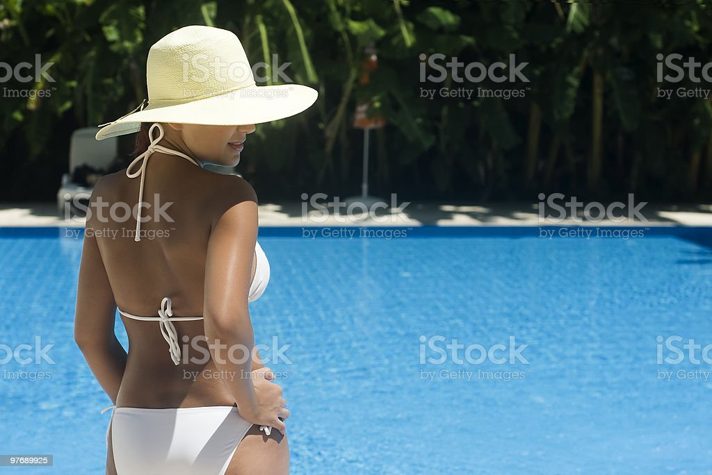 Lady with hat at the pool royalty-free stock photo
