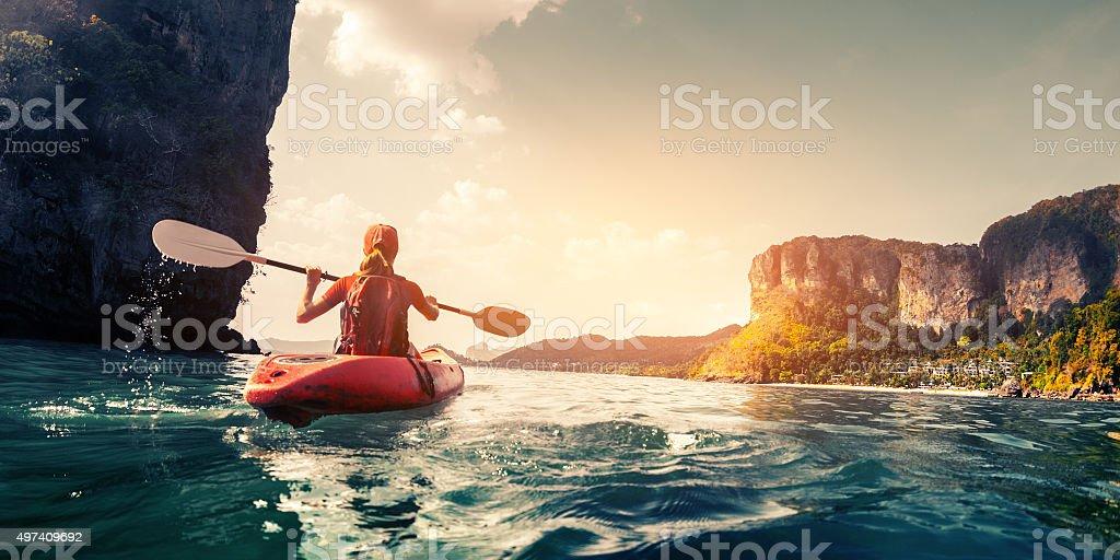 Lady with kayak stock photo