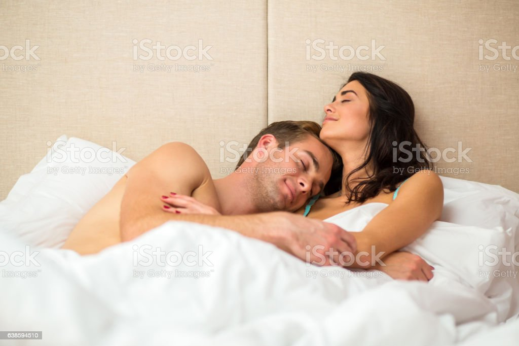 Lady with man in bed. stock photo