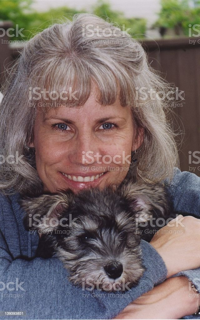 Lady with new puppy royalty-free stock photo