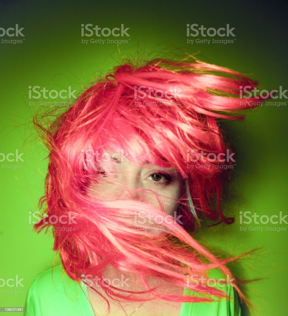 Lady with pink hair over her face royalty-free stock photo