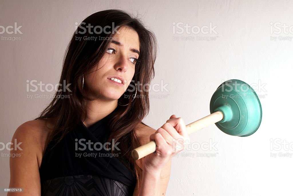Lady with plungers stock photo