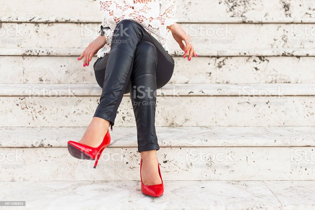 Lady with red high heel shoes stock photo
