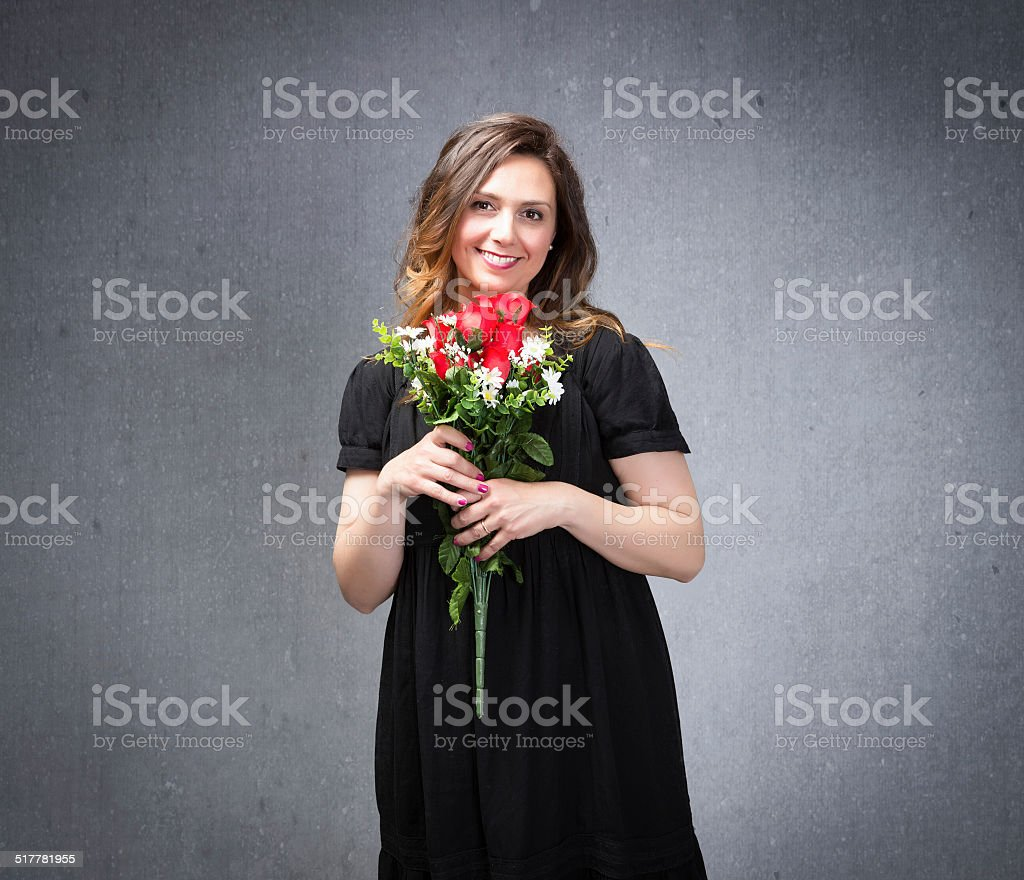 lady with red roses flowers on hand and smile face stock photo