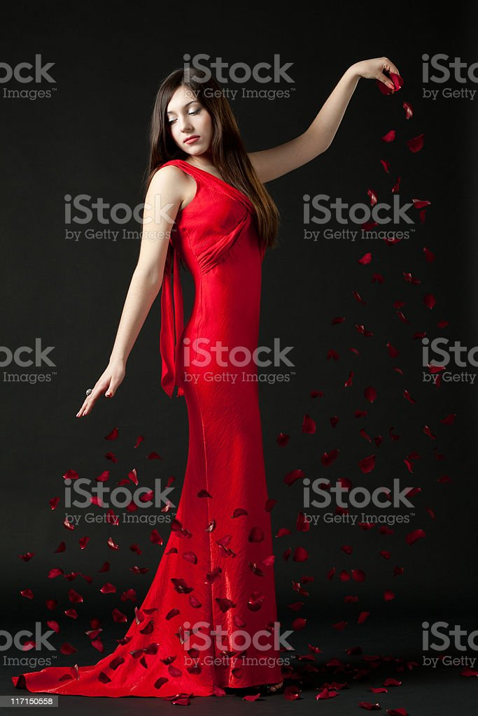 Lady with rose petals stock photo