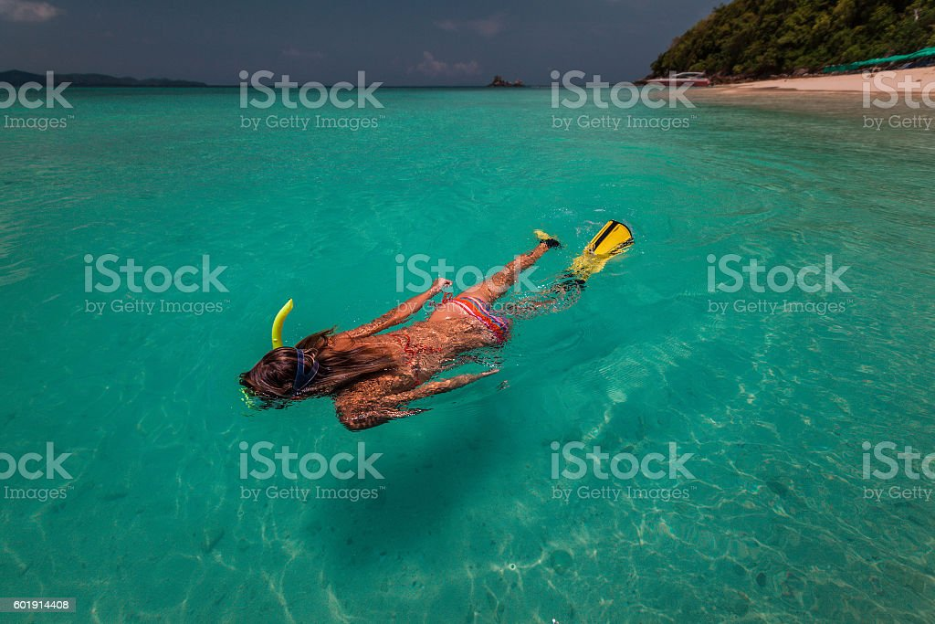 Lady with snorkel and fins stock photo