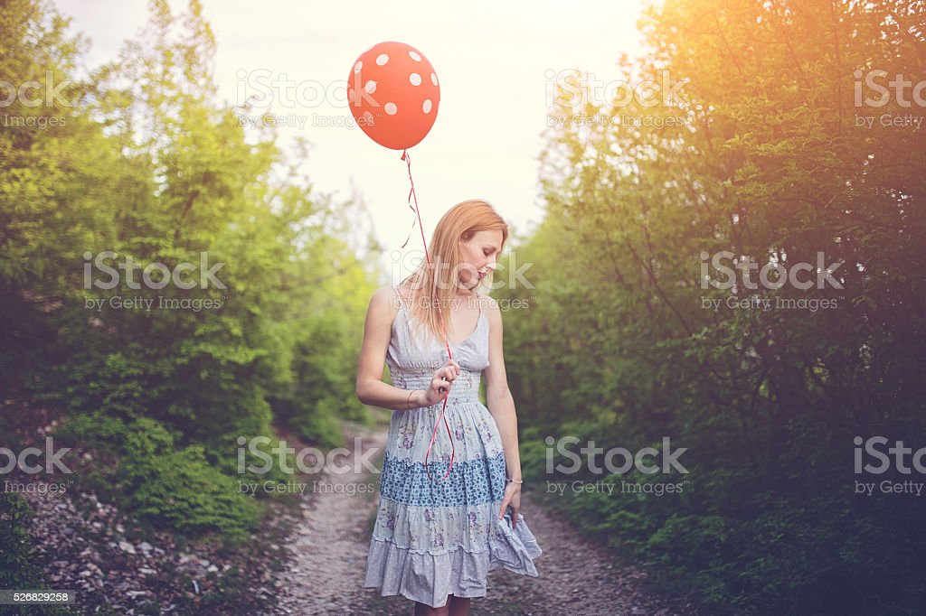 Lady with the ballon looking down stock photo