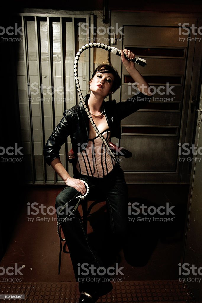 Lady with whip stock photo