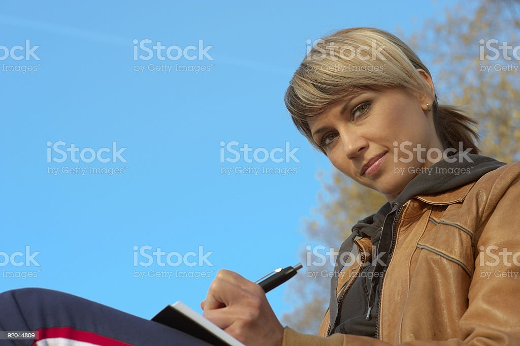Lady Writing Outdoors royalty-free stock photo