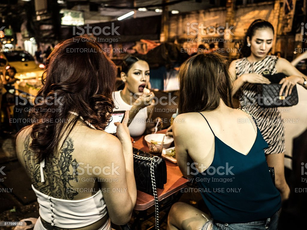 Ladyboys in Nana Plaza red light district Bangkok Thailand stock photo