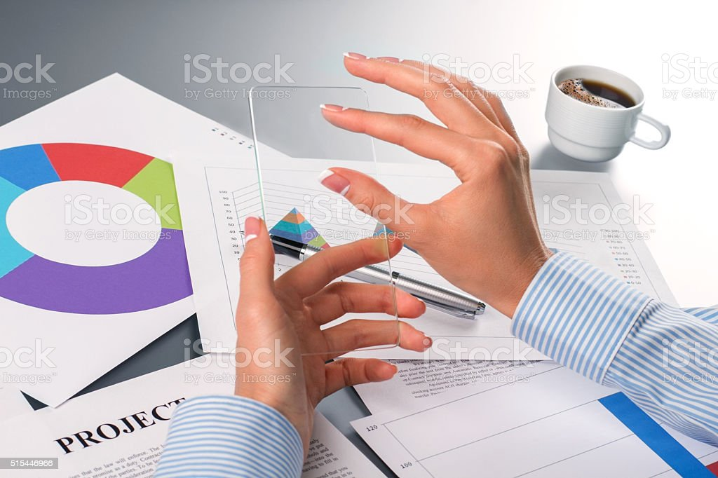 Lady's hands touching transparent smartphone. stock photo