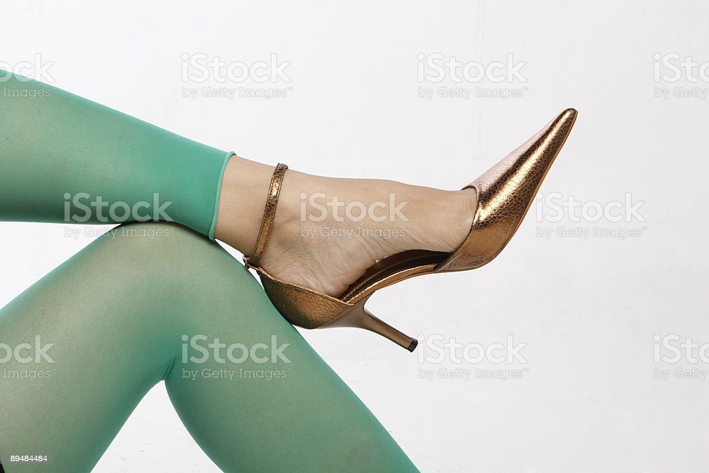lady's leg crossed over the knee stock photo