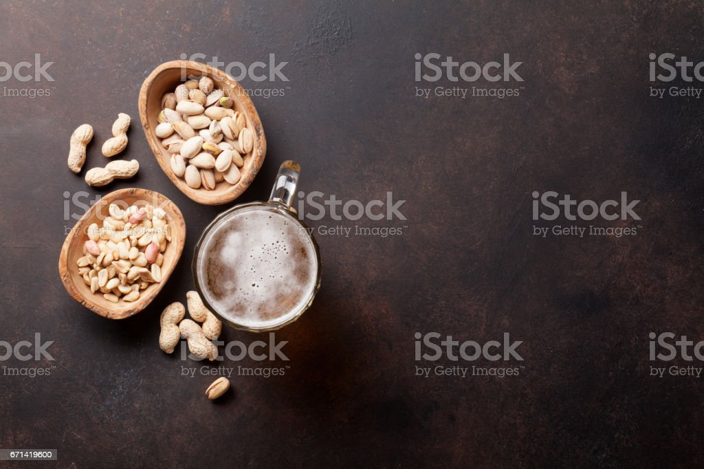 Lager beer mug and snacks stock photo