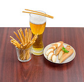 Lager beer, salty hard crispy pretzels, sliced smoked processed