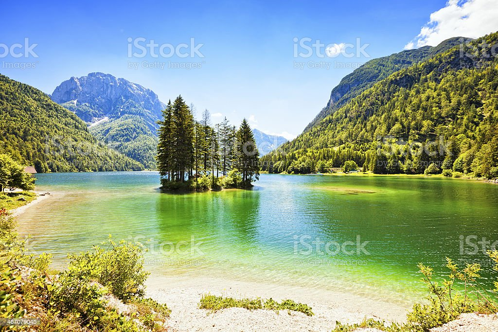 Lago del Predil lake with island, Italy royalty-free stock photo