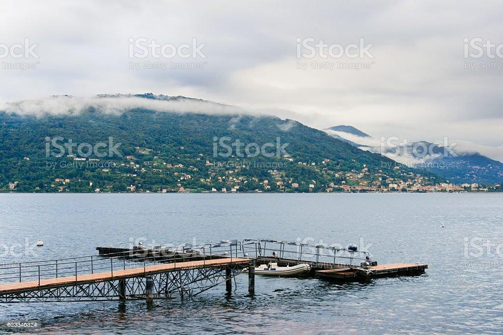 Lago (Lake) Maggiore, Pier and Alps Mountain Range, Italy. stock photo