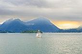 Lago (Lake) Maggiore, Tour Boat and Alps Mountain Range, Italy.