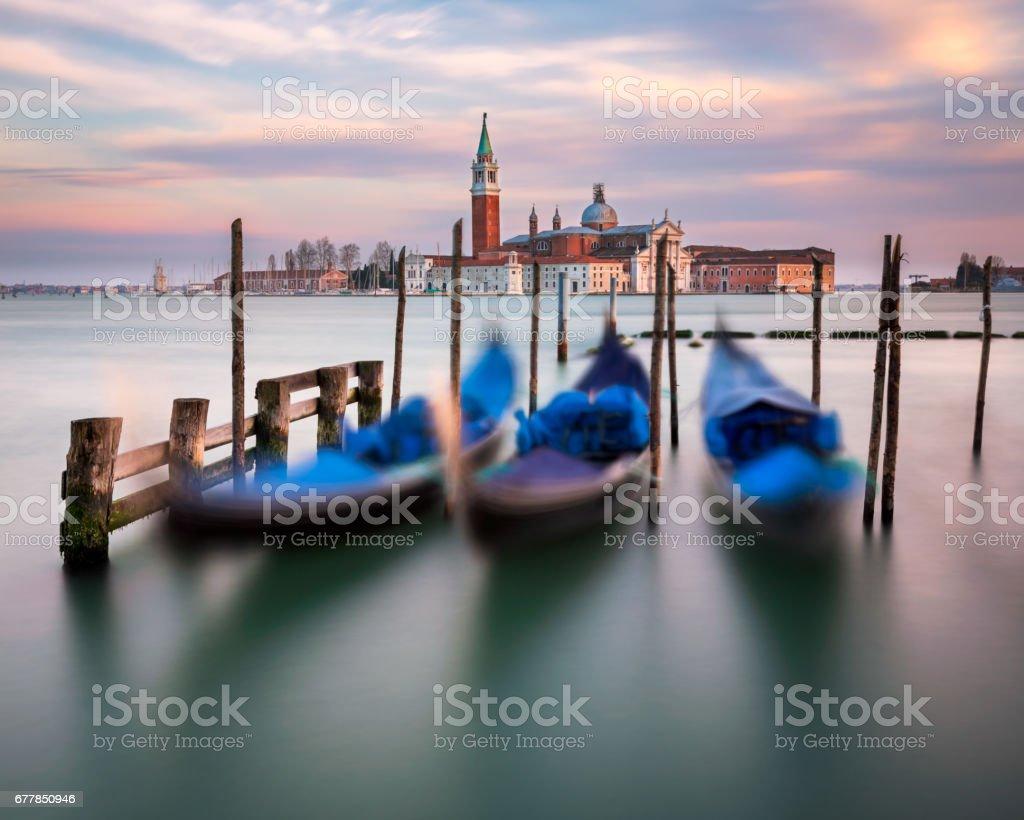 Lagoon, Gondolas and San Giorgio Maggiore Church in Venice, Italy stock photo