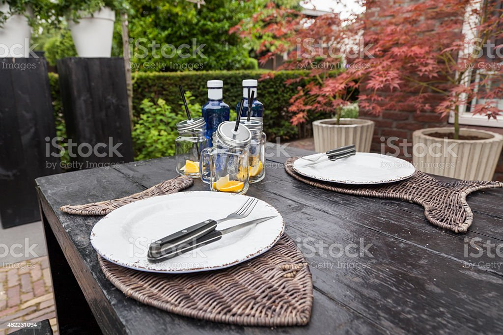 laid table in the backyard stock photo