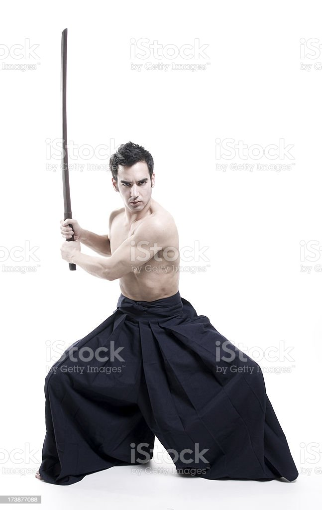 laido martial arts: young male with sword wearing kendo pants stock photo