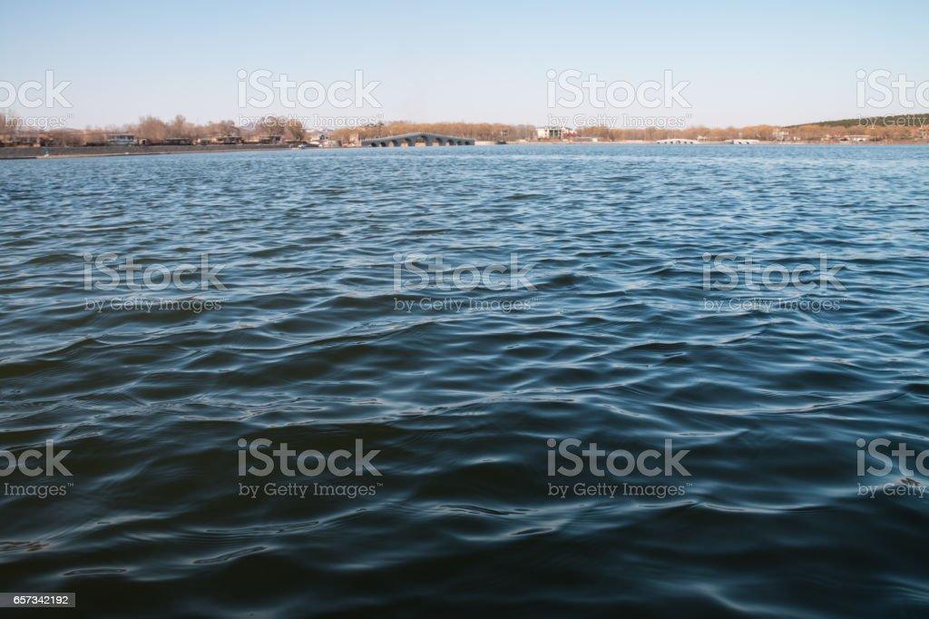 lake and arch bridge stock photo