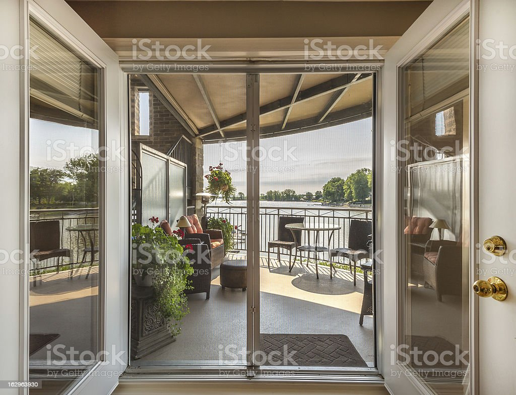 Lake and balcony view through patio doors stock photo