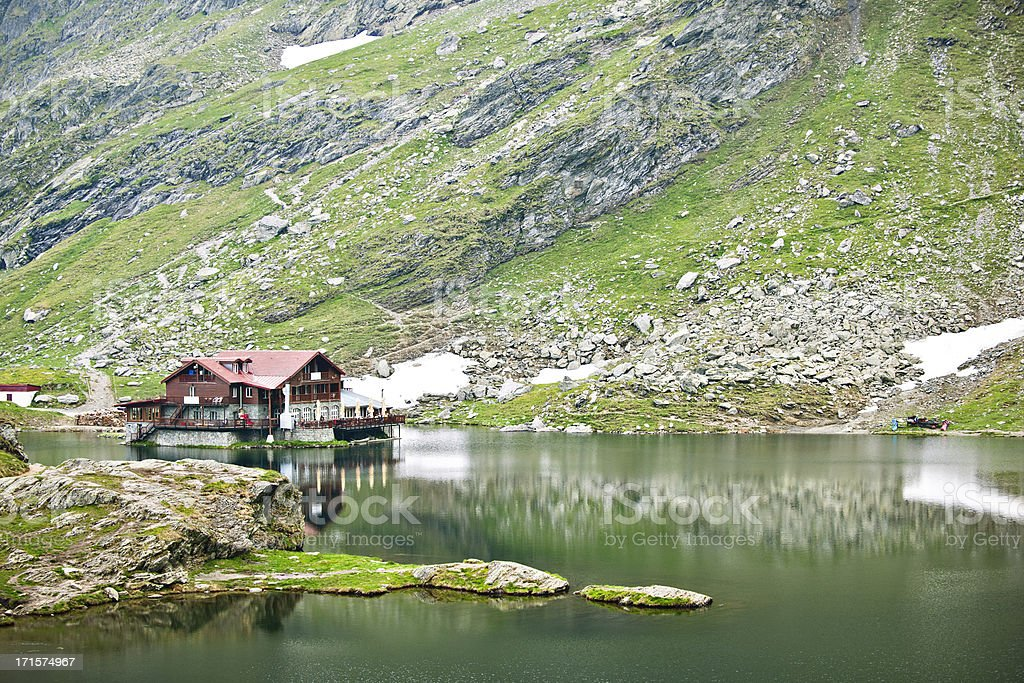 Lake and chalet stock photo