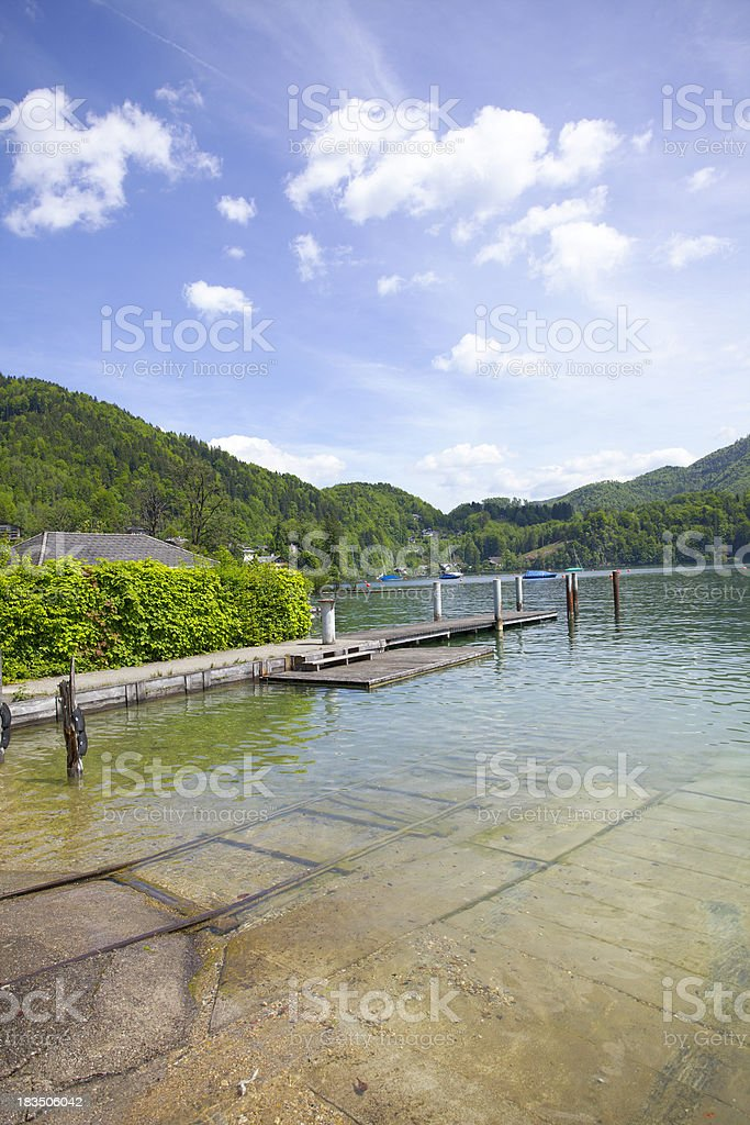 lake and cloudy sky in austria stock photo
