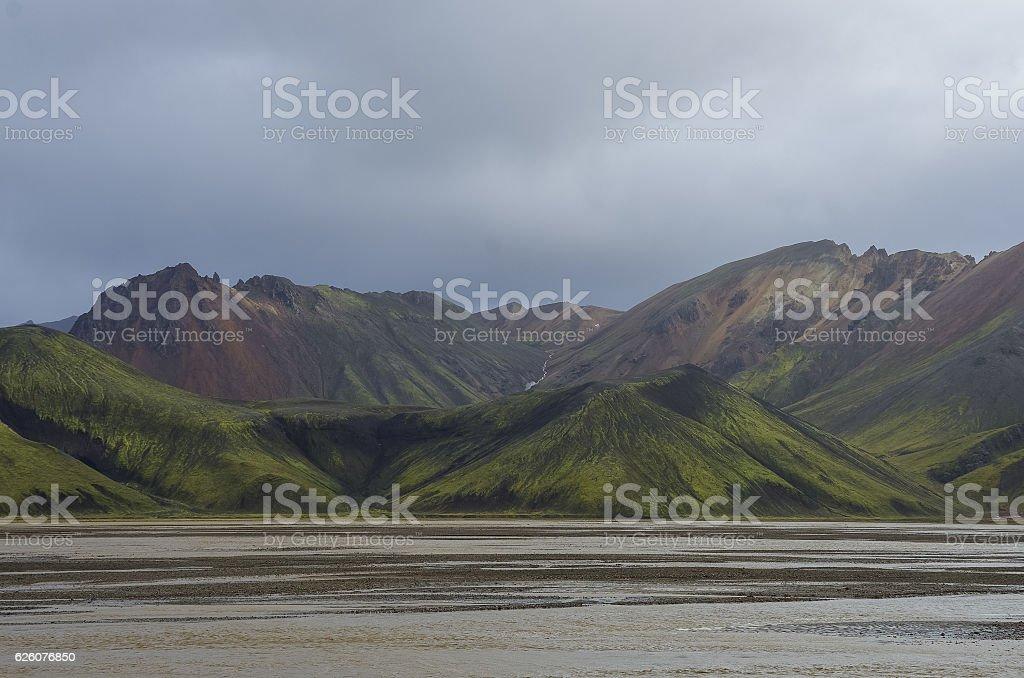 Lake and moss-covered volcanic mountains. Landmannalaugar. stock photo