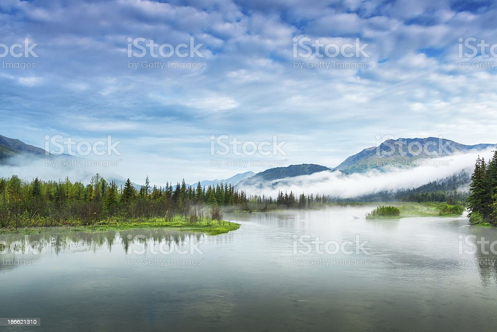 Lake and mountain landscape with early-morning fog stock photo