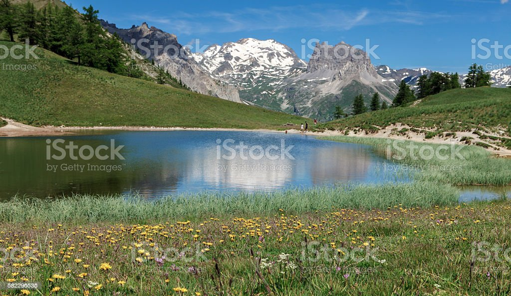 lake and mountains in the french alps stock photo