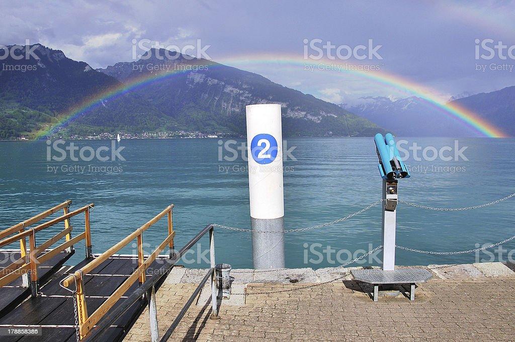 lake and rainbow in Switzerland royalty-free stock photo